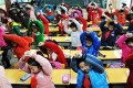 Pupils in Quanfu Primary School exercise in the classroom instead of outdoor due to smog in Jinan city, Shandong province. Photo: China Foto Press