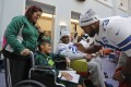 Andrea Limones and her son J.J., 9, meet Charles Brown and Mackenzy Bernadeau from the Dallas Cowboys NFL team at Cook Children's Medical Centre in Fort Worth, Texas, earlier this month. Photo: Tribune News Service