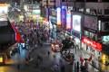 Night view of a shopping street in Zhengzhou.Photo: ImagineChina