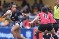 Hong Kong's Melody Li Nim-yan wrongfoots the Singapore defence during round one of the 2016 Asia Rugby Women's Sevens Series at HKFC. Photo: HKRU