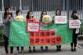 Emoticon-wielding women attempt to jerk the heartstrings of Hong Kong's government (Photo: ADPL)
