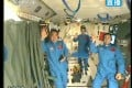 Astronauts greet a TV audience from inside Tiangong-1 on June 20, 2013 (Source: Xinhua)