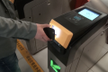 A passenger getting through subway gate by scanning a QR code. (Picture: CCTV)