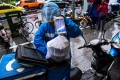 More than 322 million mobile subscribers in China are users of mobile food delivery apps. (Picture: Agence France-Presse)