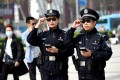 Police officers with AI-powered smart glasses in the central Chinese city of Luoyang on April 3, 2018. (Picture: Reuters)