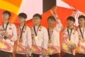 Uzi (third from left) is the captain of the team, and plays alongside two of his teammates from RNG. (Picture: Asian Games 2018)