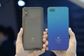 The Mi 8 Pro (left) has a 6.21 inch display, slightly smaller than the Mi 8 Lite (right)'s 6.26 inch.