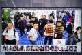 Visitors at the China International Exhibition on Public Safety and Security, filmed by security cameras with facial recognition technology, in Beijing on October 24. (Picture: AFP)