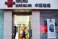 A China Unicom store in Hong Kong. Anti-corruption investigators on the mainland have been focusing on state-owned enterprises. Photo: Bloomberg
