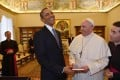 Barack Obama and Pope Francis exchange gifts at the Vatican in March. Photo: AFP