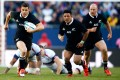 Dan Carter (left) on Thursday announced his decision to quit the All Blacks after the 2015 RWC and move to France to play for Racing Metro in the Top 14. Photos: AFP