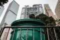 A British colonial-era mail box (C), which was painted from red to green after the city reverted to Chinese sovereignty in 1997, is pictured in the Central district of Hong Kong. Photo: AFP
