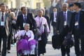 South Korean elderly people leave for North Korea to take part in family reunions with their North Korean family members at a hotel in Sokcho, South Korea. Photo: AP