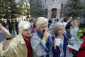 Fans dressed as the characters Dr. Emmett Brown, 1985 rich Biff (C), and as Hill preservation society lady, pose in the Hill Valley Courthouse square in Fillmore, California. Photo: AFP