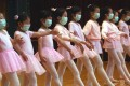 Young ballerinas in Hong Kong are shown wearing face marks in this file photo during a Sars scare in the city, which was ravaged by the virus in 2003. Photo: SCMP Pictures