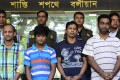 Bangladesh police parade the suspects behind the killing of 50-year-old Cesare Tavella in Dhaka. Photo: AFP
