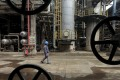 A worker walks past oil pipes at a refinery in Wuhan, Hubei province as China loadings of West African crude are seen bouncing back in November. Photo: Reuters