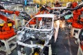Robotic arms at work on an assembly line for Chinese automaker Geely in east China's Zhejiang Province. Photo: Xinhua