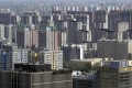 Apartment blocks and office buildings are pictured in Beijing as prices of new homes fall in October. Photo: Reuters