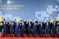 Leaders pose for a group photo at the Asia-Pacific Economic Cooperation summit in Manila on Thursday. Photo: EPA