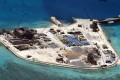 Construction work is shown at Mabini (Johnson) Reef in the disputed Spratley Islands in the South China Sea in this February 2015 file photo. China is engaged in a series of territorial disputes with its neighbours in these waters, and is now turning to the ocean to help meet its energy needs. Photo: EPA
