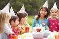 Children enjoy an outdoor birthday party. Photo: Corbis