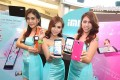 Thai models show off Xiaomi's iMi smartphones, in this file photo. The Chinese company has started selling handsets overseas but not yet in the US. This didn't stop Texas-based Blue Spike from filing a patent-infringement suit against Xiaomi in its home state last month. Photo: SCMP Pictures