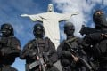 Members of the Elite Unit of the Special Police Operations Battalion (BOPE) posing between manoeuvres by the Christ the Reedemer statue in Rio de Janeiro, Brazil. Photo: AFP