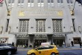 A New York city taxi passes in front of the fabled Waldorf Astoria hotel in New York, which was purchased by a Chinese insurance company as part of an outflow of investment outside the country. Photo: AP