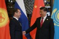 Russian Prime Minister Dmitry Medvedev and Chinese President Xi Jinping in Wuzhen, Zhejiang province, on Wednesday. Photo: EPA