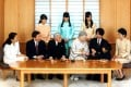 The Japanese imperial family in a portrait released on New Year's Day. Clockwise from Emperor Akihito (front, 3rd left); Crown Prince Naruhito, his wife Crown Princess Masako, and their daughter Princess Aiko; Princess Mako and sister Princess Kako, their mother Princess Kiko, her son Prince Hisahito, and husband Prince Akishino; and Empress Michiko, wife of the emperor. Photo: Reuters
