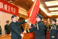 President Xi Jinping hands over a military flag to General Li Zuocheng, commander of the newly established general command of the PLA's Army. Photo: Xinhua