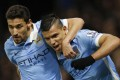 Sergio Aguero (right) celebrates with Jesus Navas after scoring the second goal for Manchester City against Watford. Photo: Reuters