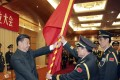 Chinese President Xi Jinping, front left, gives a military flag to Wei Fenghe, commander of the newly formed Rocket Force of the People's Liberation Army, and Wang Jiasheng, front right, political commissar of the newly formed Rocket Force. Photo: Xinhua