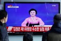 South Koreans watch Ri Chun-hee on TV news claiming North Korea successfully conducted a hydrogen bomb test at 10 am Pyongyang Time. The announcement came hours after what seems to be an artificial earthquake was detected close to the North's nuclear test site. Photo: EPA