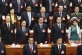 China's Politburo Standing Committee members (bottom row from L to R) President Xi Jinping, Premier Li Keqiang, Liu Yunshan and Zhang Gaoli sing Chinese national anthem during the closing session of the National People's Congress (NPC), China's Parliament, at the Great Hall of the People, in Beijing, March 15, 2015. Photo: Reuters