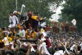 Devotees climb on top of one another to touch the religious icon of the Black Nazarene during the annual religious procession in Manila. Photo: AP