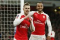 Aaron Ramsey celebrates scoring the second goal for Arsenal with Theo Walcott. Photo: Reuters