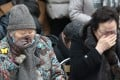 Former South Korean 'comfort women' Gil Won-ok (left) and Lee Young-soo, forced to serve the Japanese army as sex slaves during the second world war, shed tears during a weekly rally near the Japanese embassy in Seoul. Photo: EPA