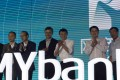 Alibaba founder Jack Ma Yun(fifth from left) is shown attending the opening ceremony of MYbank in Hangzhou, Zhejiang Province last June 25. MYbank had a registered capital of 4 billion yuan (US$655 million) and was created to focus on providing financial services for small- and micro -businesses, as well as online consumers. Photo: Xinhua