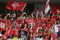 Hong Kong fans show their support at Bao'an Stadium in Shenzhen. Photo: SCMP