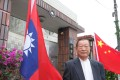 Chiang Wu, 76, a former naval captain, flies a inverted Taiwanese flag outside his house as a sign of his disillusionment with the island's President Ma Ying-jeou. Photo: Minnie Chan