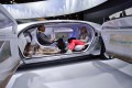Guests sit in the self-driving Mercedes-Benz F 015 concept car at the Mercedes-Benz booth at the 2015 International CES show in Las Vegas. Photo: AP