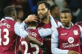 Aston Villa teammates celebrate a rare 1-0 victory over Crystal Palace. The club's fortunes have been on a downward spiral with aloof American owner Randy lerner keen to sell. Photo: Reuters