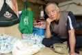 """Lam Wai-kau, 66, can't even enjoy the """"luxury"""" of a subdivided flat and works every day. Photo: Edward Wong"""