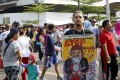 """A man holds a placard that reads """"Stop terrorists"""" in Jakarta. Photo: Reuters"""