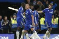 John Terry celebrates scoring the third goal for Chelsea on his 700th appearance for the club. Photo: Reuters