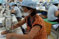 Female garment workers on a production line on the outskirts of Hanoi. Photo: AFP