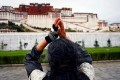 A Buddhist worships outside the Potala palace in Lhasa. Photo: SCMP Pictures