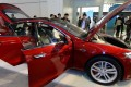 An electric car, produced by Tesla Motors, an American company that designs and builds electric vehicles, on display at a Shanghai technology fair. Photo: Xinhua